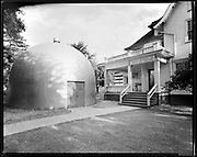"""9012-02. Oregon Museum of Science and Industry 8/12/53"""". 908 NE Hassalo. Oregon Museum of Science and Industry -- OMSI -- in its first location at 908 NE Hassalo. The domed planetarium was erected on the front lawn in 1950 -- the first one in the Pacific Northwest. OMSI was forced to move out in 1957, and eventually settled in Washington Park next to the Zoo. August 12, 1953 photo."""