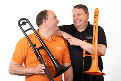 © Licensed to London News Pictures. 22/04/2019.Tamworth, Staffordshire, UK. STRICT EMBARGO: NOT TO BE PUBLISHED OR BROADCAST BEFORE 1 AM TUESDAY 23 APRIL 2019. Steven Greenall (left) and Chris Fower whose creation of pBone, the world's first plastic trombone, has been awarded a Queen's Award for Enterprise for their innovation.<br /> In just five years, Warwick Music Group's team of musicians, entrepreneurs and enthusiasts became world-leaders and the dominant manufacturer of brass instruments created in recyclable ABS plastic. Their innovative approach has radically changed a sector of the music market that has experienced little change for two centuries.<br /> Based in West Midlands, England, Warwick Music Group (WMG) now spans four continents: North America, Europe, Asia and Oceania (Australia). <br /> Photo credit: Dave Warren/LNP