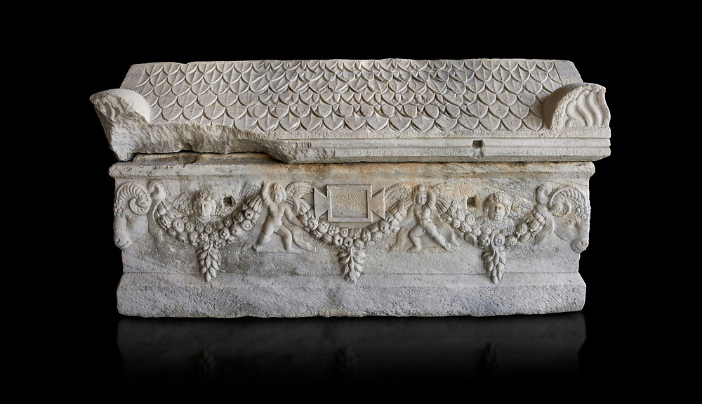 Roman relief sculpted garland sarcophagus with pitched tile sculpted roof, 3rd century AD. Adana Archaeology Museum, Turkey. Against a black background .<br /> <br /> If you prefer to buy from our ALAMY STOCK LIBRARY page at https://www.alamy.com/portfolio/paul-williams-funkystock/greco-roman-sculptures.html . Type -    Adana     - into LOWER SEARCH WITHIN GALLERY box - Refine search by adding a subject, place, background colour, museum etc.<br /> <br /> Visit our ROMAN WORLD PHOTO COLLECTIONS for more photos to download or buy as wall art prints https://funkystock.photoshelter.com/gallery-collection/The-Romans-Art-Artefacts-Antiquities-Historic-Sites-Pictures-Images/C0000r2uLJJo9_s0