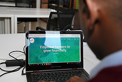 KIGALI, Oct. 30, 2018  The 26-year-old business founder Dioscore Shikama browses the website of his company in Kigali, capital of Rwanda, on Oct. 29, 2018. He set up a target to serve global farmers after participating in a training program for e-commerce business founders provided by China's e-commerce giant Alibaba in China last November. A startup hub on the 4th floor of a commercial building in Rwandan capital city Kigali is where Dioscore Shikama incubates his agri-tech e-commerce company. TO GO WITH Feature: China's e-commerce giant passes on experience to Africa, with potential benefits  djj) (Credit Image: © Lyu Tianran/Xinhua via ZUMA Wire)