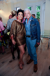 NANCY DELL'OLIO and NICKY HASLAM at a reception to celebrate the repairs on the Queen Elizabeth Gate in Hyde Park after it's successful repair following damaged sustained in a traffic accident in early 2010.  The party was held at 35 Sloane Gardens, London on 7th June 2010.