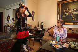"""Tatiana Hakim, 16, gets advice on her outfit  from her mother Elaine for the school holiday March Madness, Beirut, Lebanon, March 31, 2006. On this day kids dress up in crazy outfits to encourage school spirit. Her father is Sunni Muslim and mother is Maronite Christian. Although mother Elaine Hakim, technically converted to Sunni for the wedding, the family still celebrates Christian holidays, in addition to the Muslim ones. Tatiana identifies herself as """"half and half."""""""