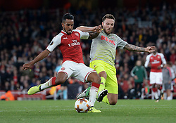 Arsenal's Theo Walcott (left) and FC Koln's Marco Hoger (right) battle for the ball