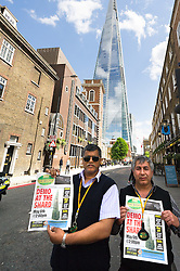 Two London Black Cab drivers protest in response to TFL's decision not to allow a Black Cab taxi rank outside the entrance to The Shard. May 2013 London