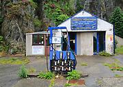 Closed filling station garage, Blaenau Ffestiniog, Gwynedd, north Wales, UK