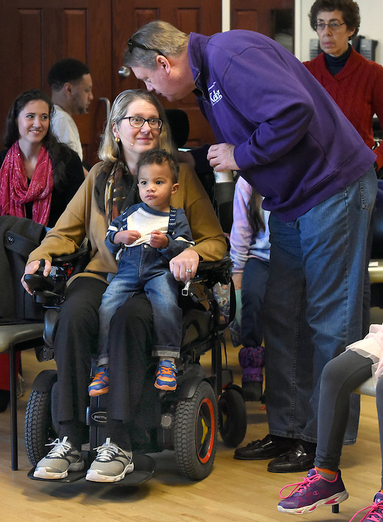 Mara Lavitt -- Special to the Hartford Courant<br /> February 14, 2016, Glastonbury<br /> Amyotrophic Lateral Sclerosis (ALS) forced Nancy Butler of Marlborough to step down as pastor of the Riverfront Family Church in Glastonbury during the Sunday service. Butler with one of her grandchildren Theeran Arulampalam age 2 of Hartford on her lap during the service speaks with her husband Greg.