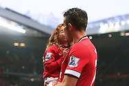 Robin van Persie of Manchester United receives a good luck kiss from his daughter before kick off - Manchester United vs. Hull City - Barclay's Premier League - Old Trafford - Manchester - 29/11/2014 Pic Philip Oldham/Sportimage
