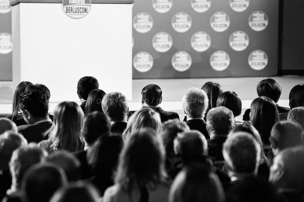 """ROME, ITALY - 24 JANUARY 2013: Silvio Berlusconi (center), former PM and leader of The People of Freedom party (PdL, Popolo della Libertà), listens Angelino Alfano, Secretary of the party, at the PdL convention in which they present the PdL candidates for the upcoming general elections in Rome, on January 25, 2013.<br /> <br /> A general election to determine the 630 members of the Chamber of Deputies and the 315 elective members of the Senate, the two houses of the Italian parliament, will take place on 24–25 February 2013. The main candidates running for Prime Minister are Pierluigi Bersani (leader of the centre-left coalition """"Italy. Common Good""""), former PM Mario Monti (leader of the centrist coalition """"With Monti for Italy"""") and former PM Silvio Berlusconi (leader of the centre-right coalition).<br /> <br /> ###<br /> <br /> ROMA, ITALIA - 24 GENNAIO 2013: Silvio Berlusconi (centro), ex-premier e leader del Popolo della Libertà, ascolta Angelino Alfano, segretario del partito, durante la convention del PdL in cui vengono presentati i candidati PdL alle prossime elezioni politiche, a Roma il 24 gennaio 2013.<br /> <br /> Le elezioni politiche italiane del 2013 per il rinnovo dei due rami del Parlamento italiano – la Camera dei deputati e il Senato della Repubblica – si terranno domenica 24 e lunedì 25 febbraio 2013 a seguito dello scioglimento anticipato delle Camere avvenuto il 22 dicembre 2012, quattro mesi prima della conclusione naturale della XVI Legislatura. I principali candidate per la Presidenza del Consiglio sono Pierluigi Bersani (leader della coalizione di centro-sinistra """"Italia. Bene Comune""""), il premier uscente Mario Monti (leader della coalizione di centro """"Con Monti per l'Italia"""") e l'ex-premier Silvio Berlusconi (leader della coalizione di centro-destra).ROME, ITALY - 24 JANUARY 2013: Silvio Berlusconi, former PM and leader of The People of Freedom party, and Angelino Alfano, Secretary of the party, present the PdL candidates for the upcoming g"""