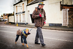 DATE CORRECTION. IMAGES SHOT 14/01/2017 © Licensed to London News Pictures. 14/01/2017. Whittlesey UK.. Picture shows a Musician & his dog from the Wakefield Morris dancers arriving at the 38th Whittlesey Straw Bear festival. In times past when starvation bit deep the ploughmen of the area where drawn to towns like Whittlesey, They knocked on doors begging for food & disguised their shame by blackening their faces with soot. In Whittlesey it was the custom on the Tuesday following Plough Monday to dress one of the confraternity of the plough in straw and call him a Straw Bear. The bear was then taken around town to entertain the folk who on the previous day had subscribed to the rustics, a spread of beer, tobacco & beef. The bear was made to dance in front of houses & gifts of money, beer & food was expected. Photo credit: Andrew McCaren/LNP