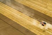 Nederland, Drenthe, Gemeente Borger-Odoorn, 05-08-2014; Eerste Exloermond, Heeren- of Markiezenplaatsen. Graanoogst in de veenkolonien. De combine maait het graan en dorst dit direct, het zgn. maaidorsen. Naast de maaidorser een kipwagen voor de afvoer van het graan. De lijnen in het graan zijn veroorzaakt door de beregeningsinstallatie.<br /> Grain harvest in a peat landscape, East Netherlands (near German border). The combine reaps the grain and threases it. Next to the combine harvester a dumper for the discharge of the grain. The liens in the grain are caused by the irrigation system for crops<br /> luchtfoto (toeslag op standard tarieven);<br /> aerial photo (additional fee required);<br /> copyright foto/photo Siebe Swart