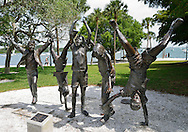 """USA: Sarasota County: Sarasota: """"Olympic Wannabees"""" bronze sculpture by Glenna Goodacre at the scenic Island Park area of the Sarasota Bayfront Park is one of numerous public art displays nearby.  Sarasota's waterfront was recently named a great waterfront by USA Today."""