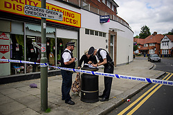 © Licensed to London News Pictures. 12/08/2017. London, UK. A police cordon near a property on Golders Green Crescent in Golders Green where the bodies of two women were found on Friday night. The women aged 33 and 66, thought to be mother and daughter, were suffering from stab wounds - both were pronounced dead at the scene. Joshua Cohen, 27 was arrested by police in connection with the killings, at a park near the scene. Photo credit: Ben Cawthra/LNP