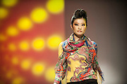 A model showcases designs on the runway by Pashma during the Memory Lane show on day 1 of Hong Kong Fashion Week Autumn/Winter 2013 at the Convention and Exhibition Centre on January 14, 2013 in Hong Kong, China. (Photo by Victor Fraile/Getty Images)