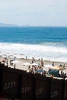 Crowded Playa de Tijuana Beach and U.S. / Mexico International Border, Border Field State Park, California