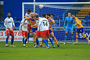 Farrend Rawson of Mansfield Town (6) heads the ball during the The FA Cup match between Mansfield Town and Dagenham and Redbridge at the One Call Stadium, Mansfield, England on 29 November 2020.