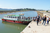 Boat trippers disembark at Somo, small town on the Bay of Santander, Santander, Spain, May, 2015, 201505080903<br />