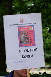 June 24, 2017 - London, England, United Kingdom - A man holds a placard calling for the US to leave Korea.  Six people from the Korean friendship association hold a protest against the US in Korea outside the Korean embassy in London, UK, on 24 June 2017. (Credit Image: © Jay Shaw Baker/NurPhoto via ZUMA Press)
