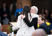 Ledell Zellers embraces a fellow Alder before the swearing in ceremony for Satya Rhodes-Conway and newly elected Alders at the City County Building in Madison, WI on Tuesday, April 16, 2019.