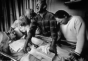 Tom Fox surrenders to the ravages of AIDS surrounded by his family. Eugene, Orgeon