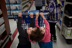 Craniopagus twins Krista and Tatiana Hogan push their shopping cart during a trip to Walmart in Vancouver, British Columbia, Canada, March 1, 2011. The twins, who are connected at the head and share a brain, were in the city during a routine visit to their many doctors. Born Oct. 25, 2006 to parents Felicia Simms and Brendan Hogan, neurologists say the twins are the only such set that have a common neurological connection.