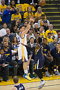 Golden State Warriors guard Klay Thompson (11) shoots a jumper of the Utah Jazz during Game 2 of the Western Conference Semifinals at Oracle Arena in Oakland, Calif., on May 4, 2017. (Stan Olszewski/Special to S.F. Examiner)