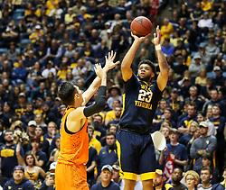 Feb 10, 2018; Morgantown, WV, USA; West Virginia Mountaineers forward Esa Ahmad (23) shoots a jumper during the second half against the Oklahoma State Cowboys at WVU Coliseum. Mandatory Credit: Ben Queen-USA TODAY Sports