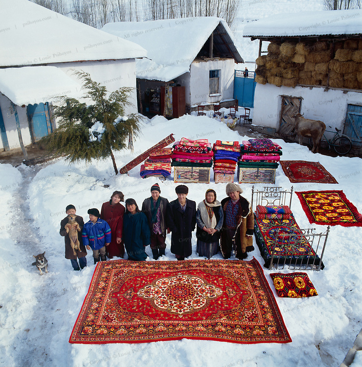 The Kalnazarow Family and all their material possessions outside their home near Taschkent, Uzbekistan.