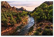 Majestic sandstone peaks frame the Virgin River at Zion National Park, Utah, USA