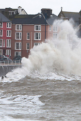 © Licensed to London News Pictures. 05/02/2014. Aberystwyth, UK High tide brings more huge waves smashing into the prom at Aberystwyth.. Photo credit : John Freeman/LNP