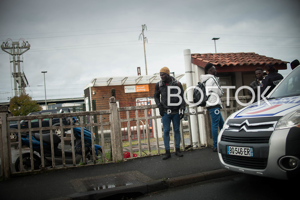 Some African migrant who just crossed the Spanish French border stopped by a French police patrol, near the train station. Hendaia (Basque Country). January 26, 2019. As the number of migrants arriving on the coasts of southern Spain incresead, more and more migrants are heading north to the border city of Irun. (Gari Garaialde / Bostok Photo)