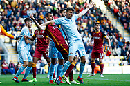 Bradford City defender Ryan McGowan (4) is tightly marked by Sunderland defender Tom Flanagan (12)  during the EFL Sky Bet League 1 match between Bradford City and Sunderland at the Northern Commercials Stadium, Bradford, England on 6 October 2018.