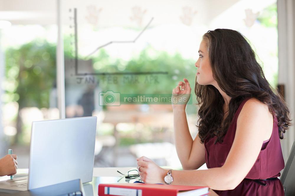 Businesswoman sitting in meeting (Credit Image: © Image Source/Albert Van Rosendaa/Image Source/ZUMAPRESS.com)