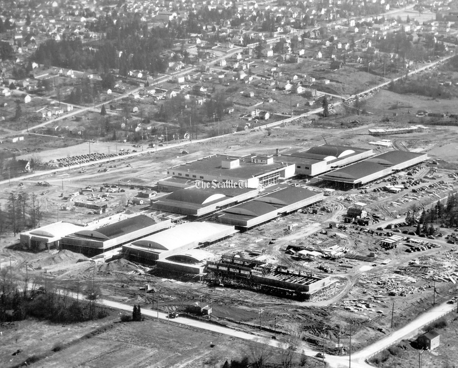 Aerial view of construction of the Northgate Shopping Center on March 3, 1950. This view is looking southeast, with Fifth Avenue Northeast in the background and Northeast Northgate Way running left to right in foreground. The building under construction in the foreground is Northgate Hospital. (Seattle Times archive)