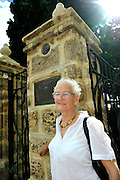 Rachel Blythe, the great great grand-daughter of Sir James Stirling, standing beside the newly restored Stirling Memorial Gates