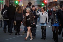© London News Pictures. 01/05/2016. Oxford, UK. A bare footed woman makes her way through Oxford City centre as Oxford University students and members of the public celebrate May Day in the early hours of the morning near Magdalen Bridge in Oxford, Oxfordshire. This year people were again prevented from jumping from the bridge in to the water due to serious injuries sustained at a previous years event . Photo credit: Ben Cawthra/LNP