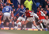 Robert Pires and Sylvain Wiltord (Arsenal) challenged by Stephen Hughes and Gary Naysmith (Everton). Everton v Arsenal. FA Premiership 18/11/2000. Credit: Colorsport / Andrew Cowie.