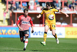 Newport County's Regan Poole is tackled by Exeter City's Lee Holmes - Photo mandatory by-line: Harry Trump/JMP - Mobile: 07966 386802 - 06/04/15 - SPORT - FOOTBALL - Sky Bet League Two - Exeter City v Newport County - St James Park, Exeter, England.