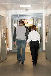 Suspect being taken to the cells in Middlesborough police station