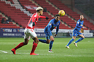 Charlton Athletic attacker Lyle Taylor (9) clearing the ball during the EFL Sky Bet League 1 match between Charlton Athletic and AFC Wimbledon at The Valley, London, England on 15 December 2018.