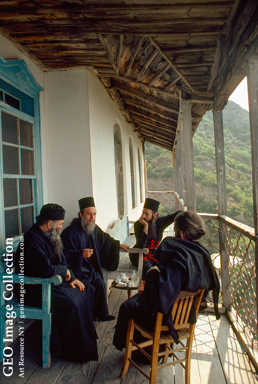 After morning service and early meal, monks have a discussion on the rectory balcony.