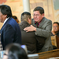 012615  Adron Gardner/Independent<br /> <br /> Alton Shepherd and  Lorenzo C. Bates, right, embrace after Shepherd conceded to Bates after a 12 to 12 vote tie for election of a tribal council speaker during the Navajo Nation Tribal Council winter session in Window Rock Monday.