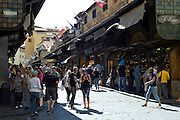 Tourists and locals on the Ponte Vecchio north side of the River Arno, Florence, Tuscany, Italy