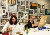 Artists DJ Geribo and Shirley Fitzgerald work on current pieces at the Lakes Region Art Association's gallery space in the Tanger Outlet on Friday afternoon.  (Karen Bobotas/for the Laconia Daily Sun)