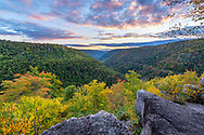 Fall color is beginning to show over Blackwater Canyon from the overlook of Pase Point at sunset.