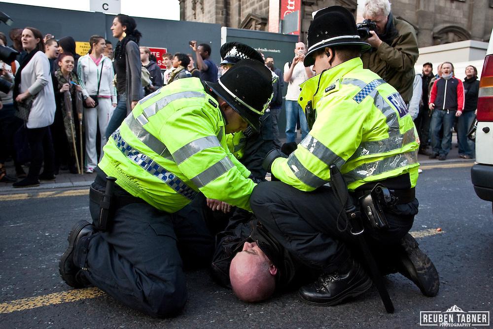 Police arrest an EDL supporter.