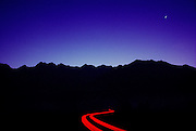 Mountains, pre dawn sky, star trails and car trails