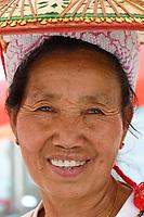 Lisu people, Portrait of an old happy woman in Xiang Bai village, Dehong, Yunnan, China