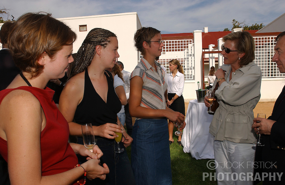 STELLENBOSCH, SOUTH AFRICA - Princess Astrid talks with Belgian students who are attending Stellenbosch University, an Afrikaans University where all undergraduate classes are taught in the Afrikaans language. The graduate level courses are taught in English. From left to right: Evelien Storme, 21, of Mechelen, Lieve Vanleeuw, 26, of Limburg, and Katrien Quirijnen of Merksplas. (PHOTO © JOCK FISTICK)<br />