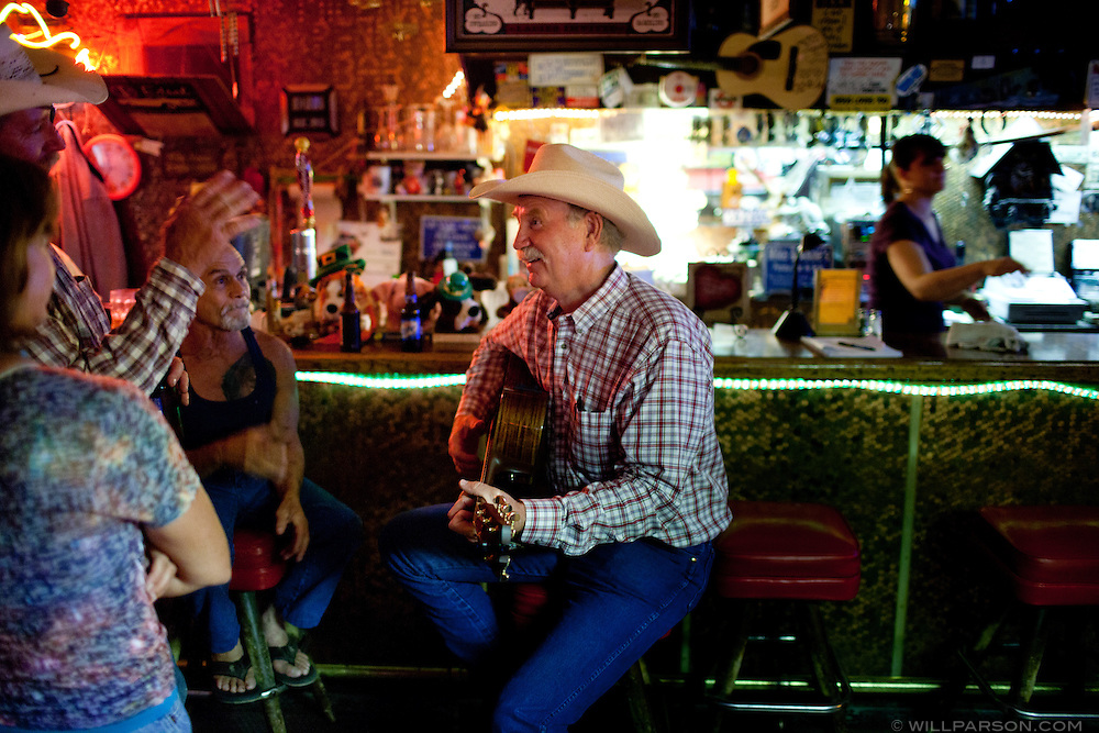 """J Parson takes requests at the Penny Bar in McKittrick, California. One of J's latest songs, """"Annie and the Penny Bar"""" is about bar proprietor Annie Moore."""