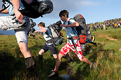© licensed to London News Pictures. Okehampton, UK 14/05/2011 A group jumps over a small stream at the start of the event. Thousands of young people take part in the 2011 Ten Tors event on Dartmoor today (Sat), which has routes of 35, 45 and 55 miles. Please see special instructions for usage rates. Photo credit should read London News Pictures